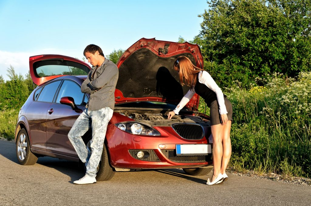 a couple is looking for roadside assistance
